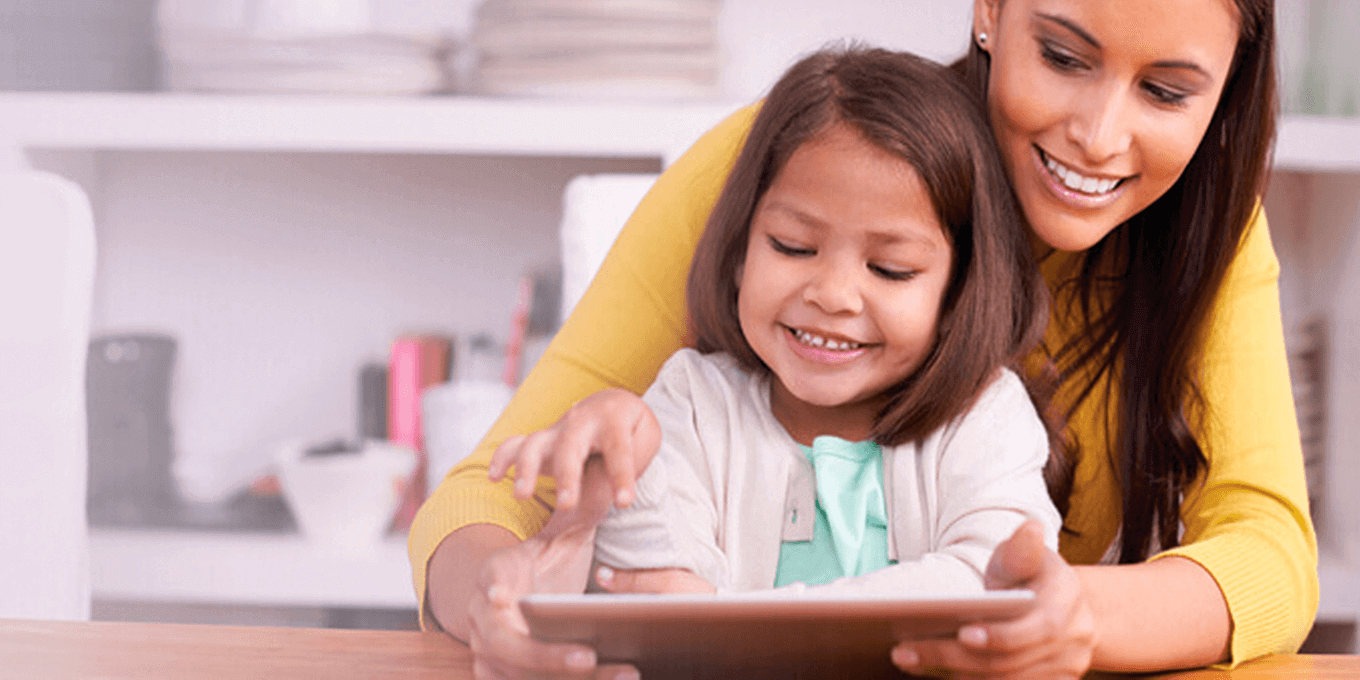 Image of mother and daughter interacting with a tablet.